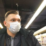 Man walking through pharmacy – zoomed out