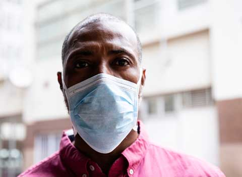 Black male with medical face mask